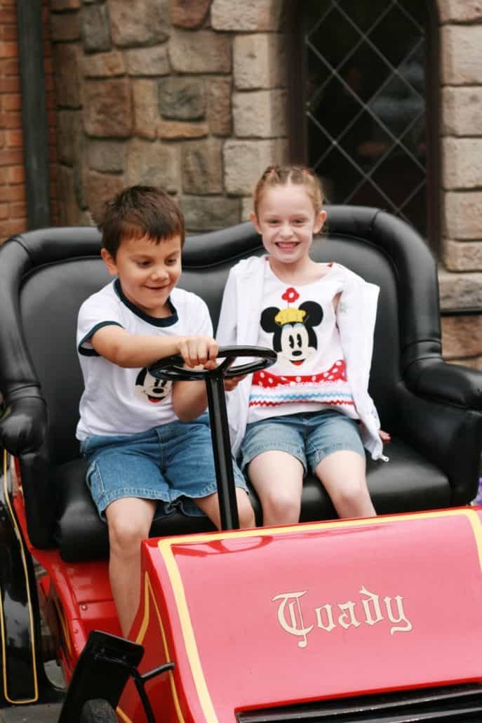 Boy and girl in Mr. Toad's Wild Ride car at Disneyland