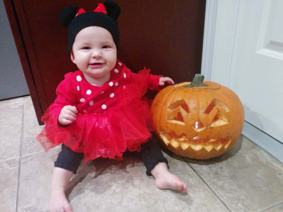 Baby dressed as Minnie Mouse
