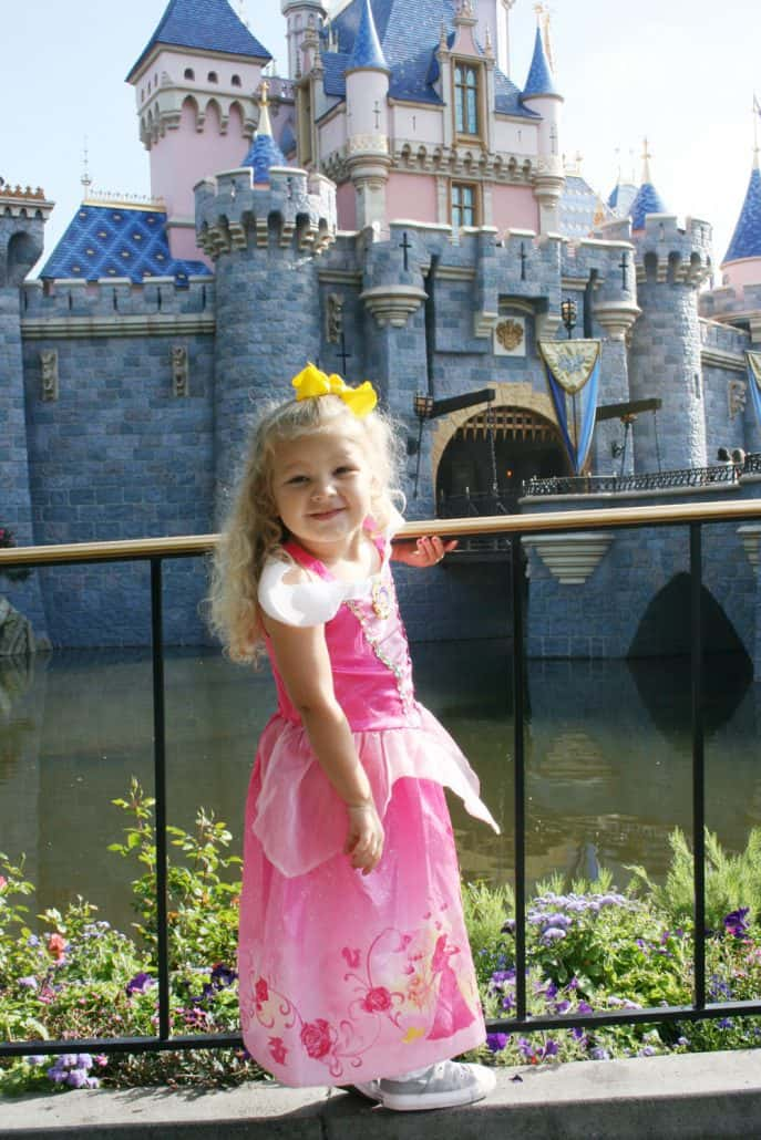 Little girl wearing Princess Aurora Sleeping Beauty dress at Disneyland