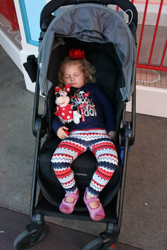 Toddler sleeping in a stroller at Disneyland