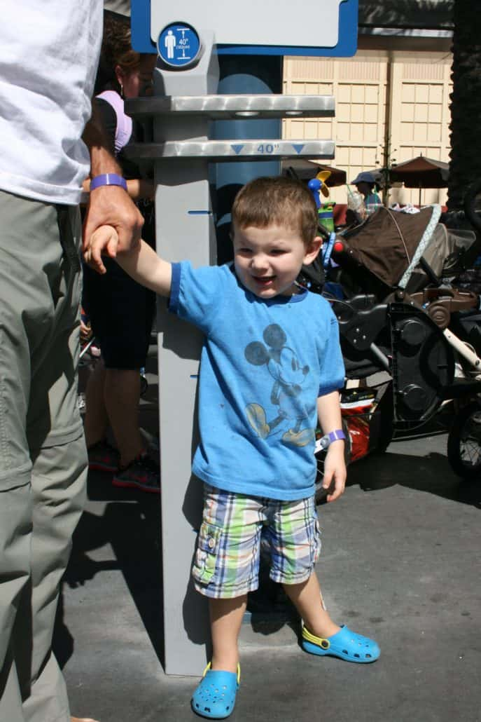 Measuring a toddler at Disney Soarin' attraction