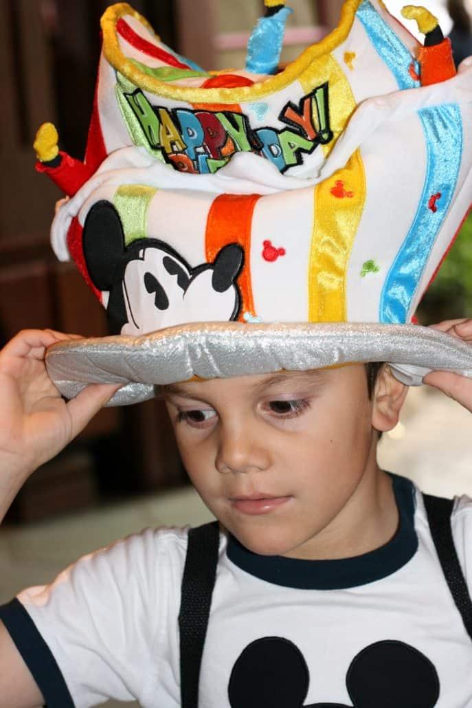 Boy wearing a birthday cake hat at Disneyland