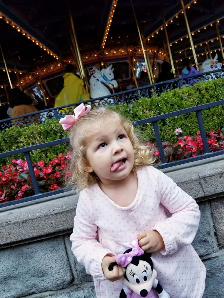 Toddler standing in front of the carrousel at Disneyland