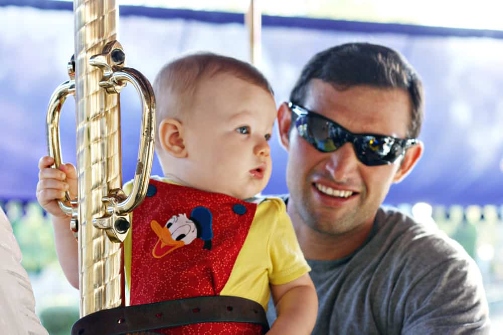 King Arthur Carrousel at Disneyland with a baby