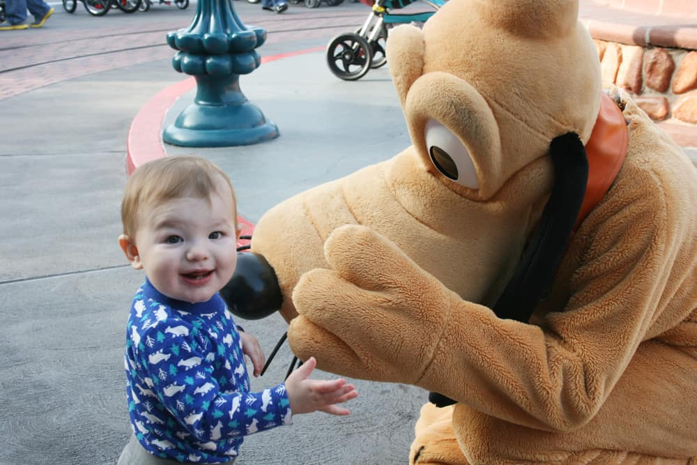 Pluto at Disneyland with a baby