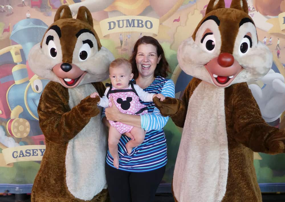 Woman and baby at Disney World with Chip and Dale