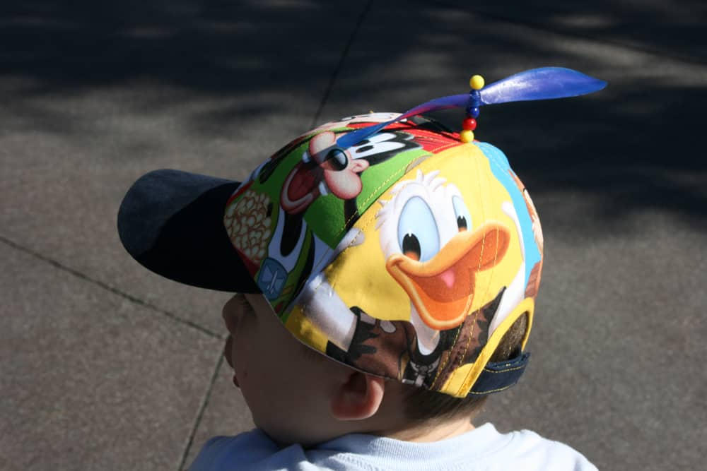 Child wearing a Disney hat
