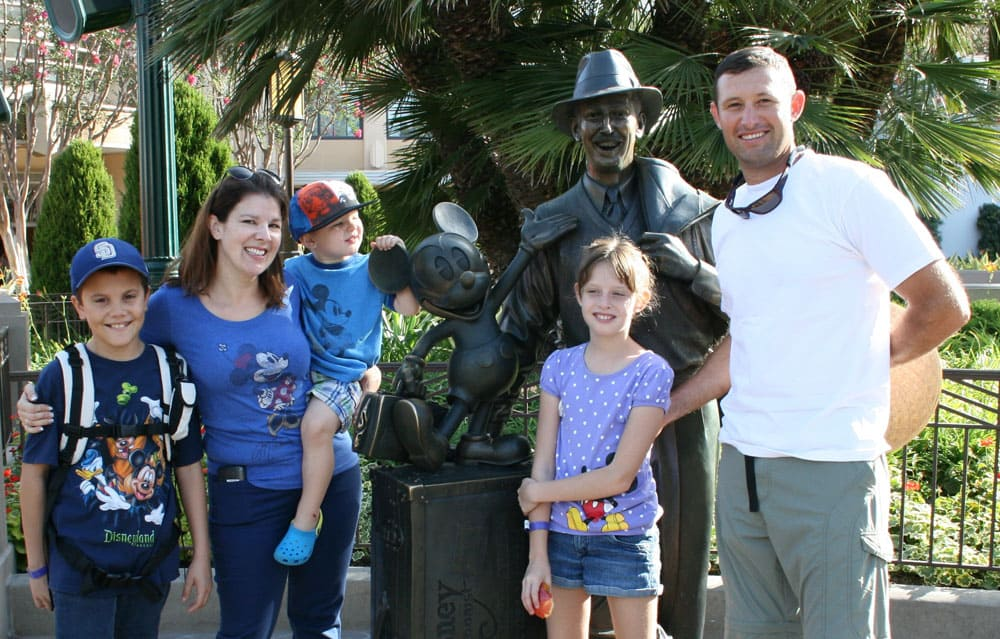 Family at Walt statue in Disney California Adventure