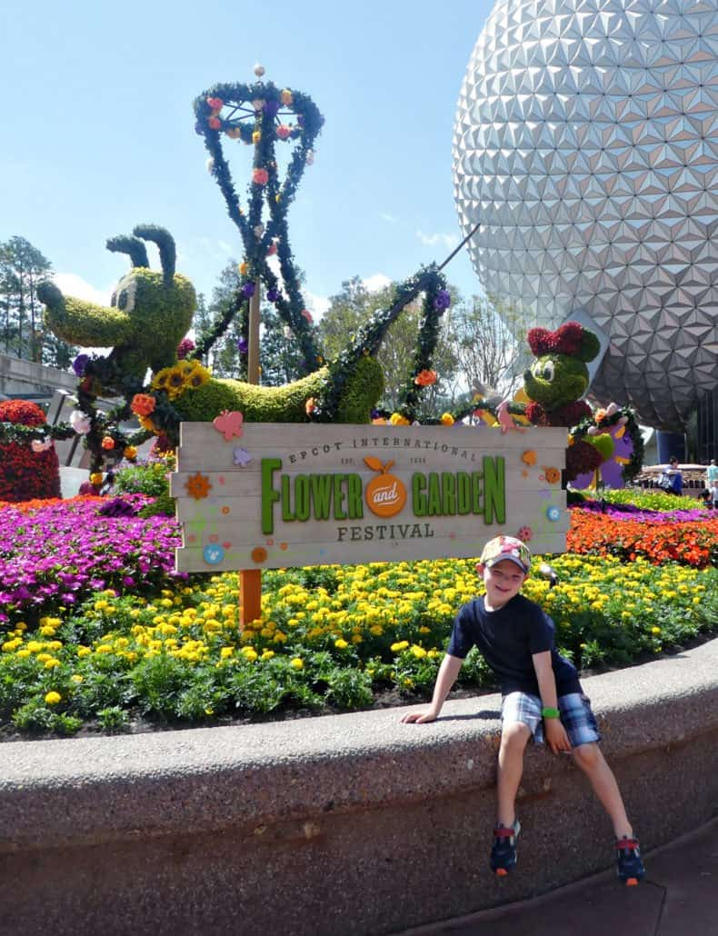 Epcot International Flower and Garden Festival front entrance with a kid