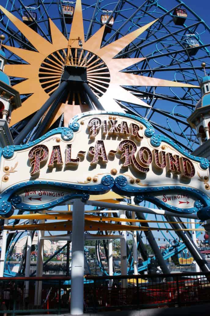 Pixar Pal-a-Round sign and Ferris wheel gondolas