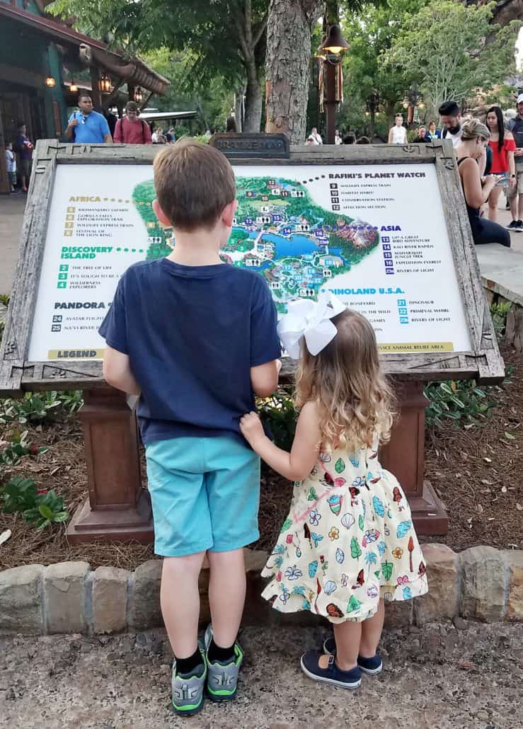 Kids looking at the park map at Disney World Animal Kingdom