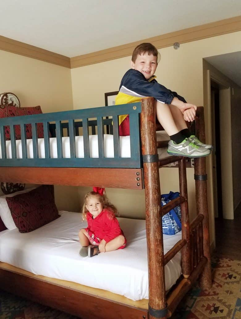 Wilderness Lodge hotel at Disney World with kids sitting on bunk beds