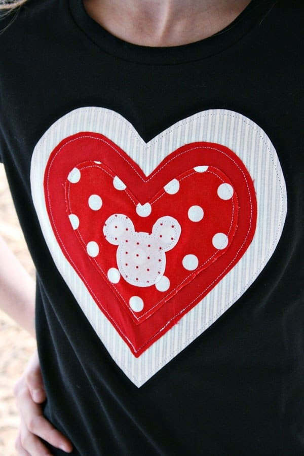Looking for an easy Valentine's craft to make for the kids? This quick applique technique is easy to put together in about an hour, resulting in an adorable Valentine's Day heart tee to wear year 'round! Sew it on a pillowcase or t-shirt. There's even a Hidden Mickey Disney detail in the center for added love! Perfect for Valentine's Day or just to show your love of Disney. #ValentinesDay #Applique | Sewing | Crafts