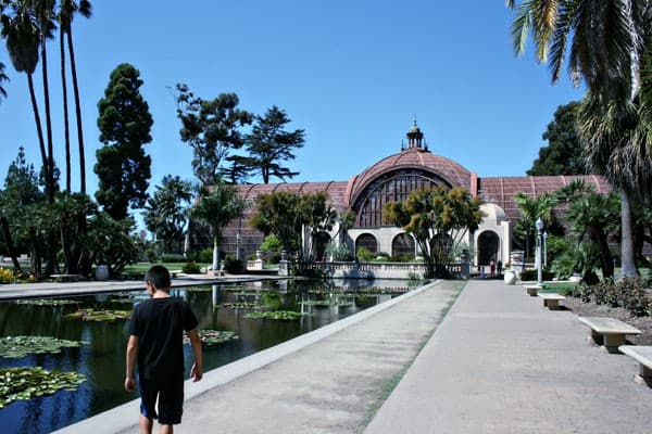 Kid near lily pond in Balboa Park