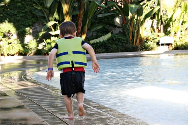 Child wearing a life jacket at the Disneyland hotel pool