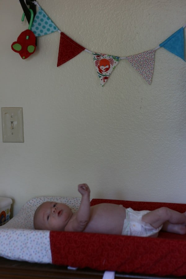 Changing table cover in my son's room, along with a coordinating banner above the table.