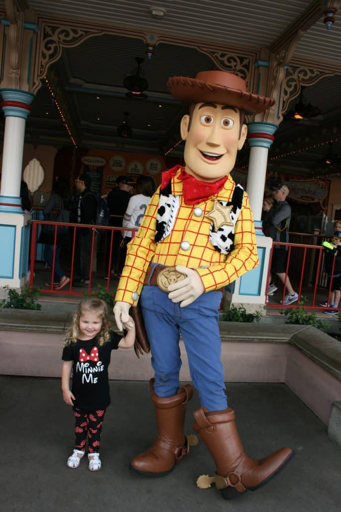 Preschooler with Toy Story Woody at Disney California Adventure