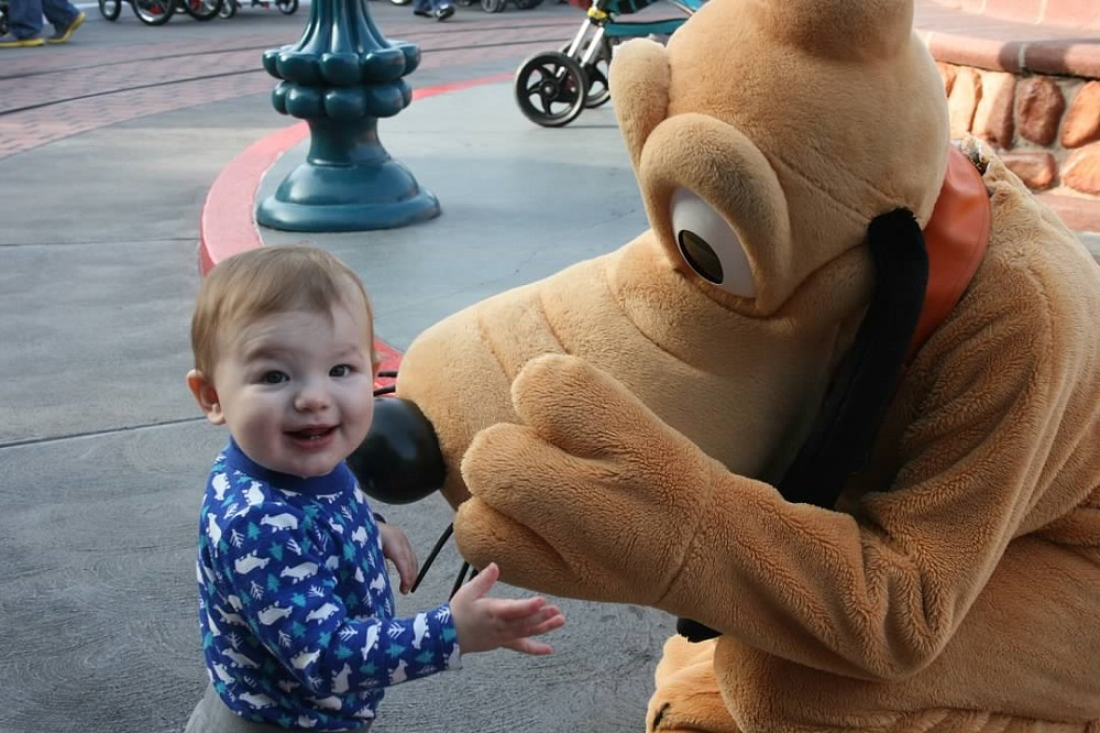 Toddler boy with Pluto in Disney's Toontown