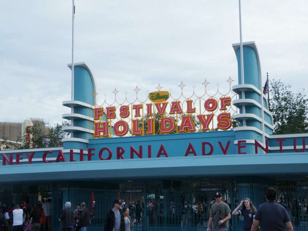 Front entrance to Disney California Adventure with Festival of Holidays sign