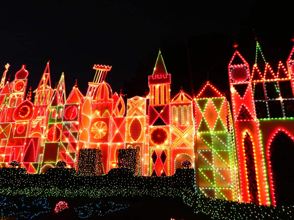 it's a small world holiday dramatically lights up at night.