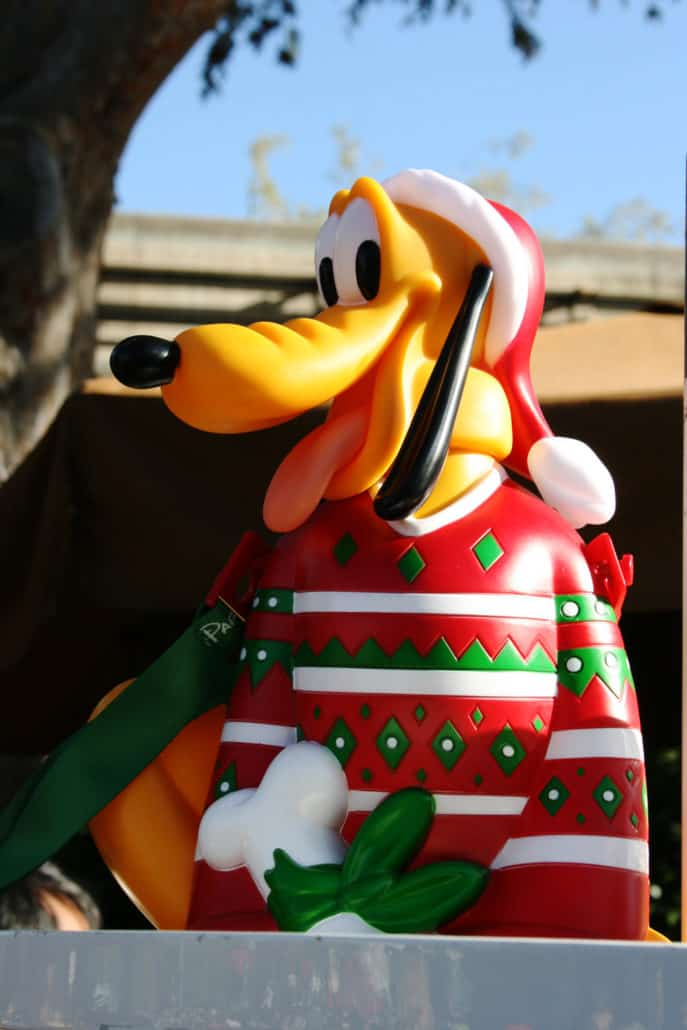 Pluto wearing a Christmas sweater in a Disneyland souvenir popcorn bucket