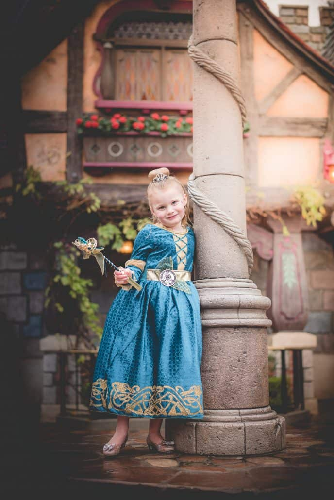 A & C Photography child dressed in Brave Merida costume at Disneyland Bibbidi Bobbidi Boutique
