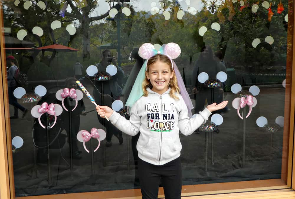 Glow with the Show Disneyland Mouse Ears in Disney Store window