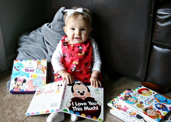 Baby with a stack of books