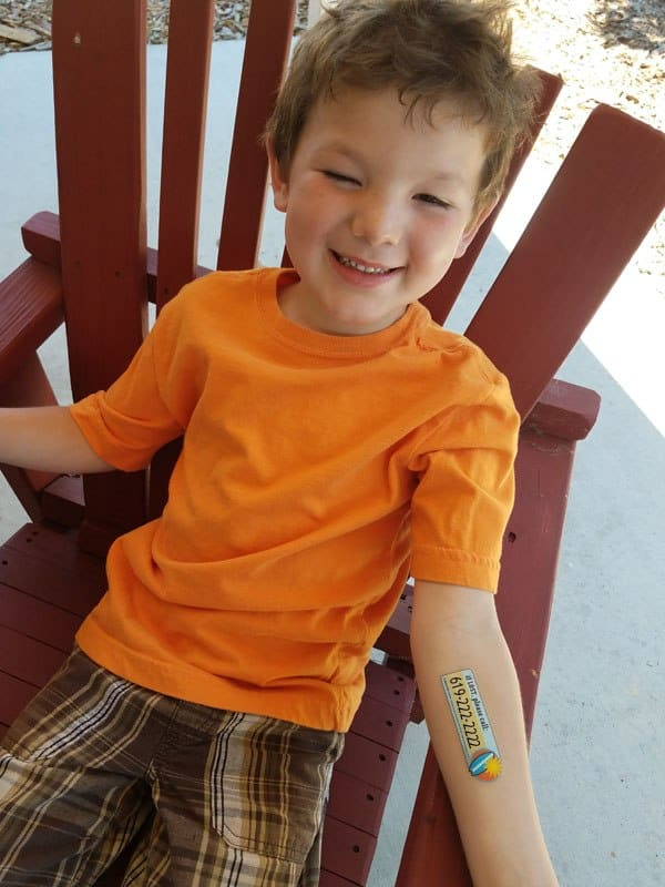 Boy wearing a Safety Tat, waterproof personalized tattoo on his arm