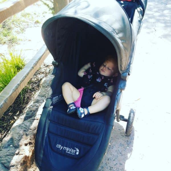 Baby sleeping in a stroller at Disney World