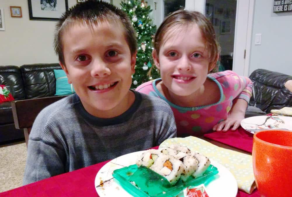 Kids with a plate of sushi