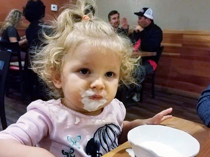 Baby with a messy face eating at Souplantation