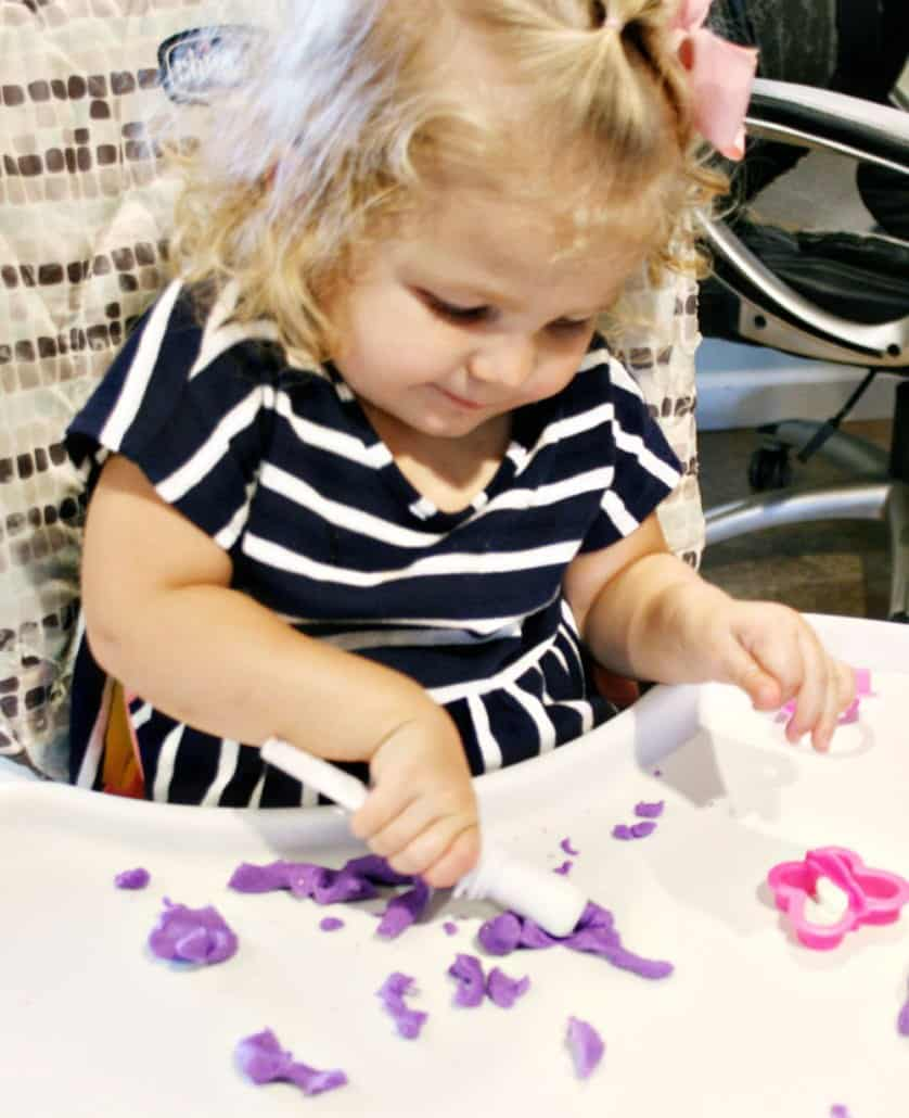 Toddler playing with clay