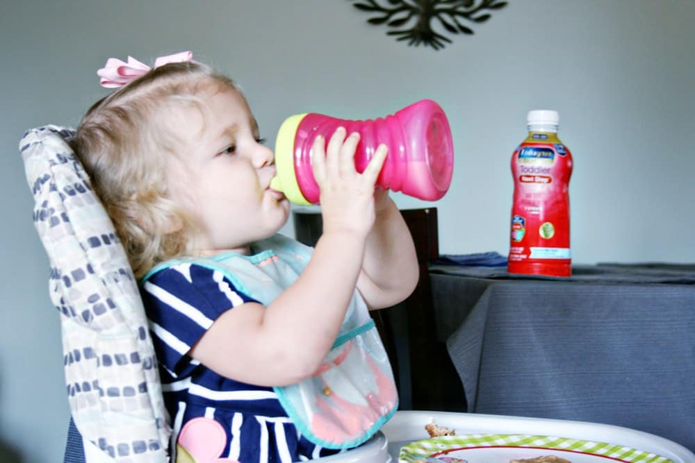 Little girl drinking out of a sipper cup
