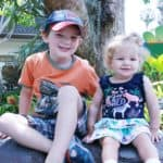 Two young children sitting on a rock at the San Diego Zoo