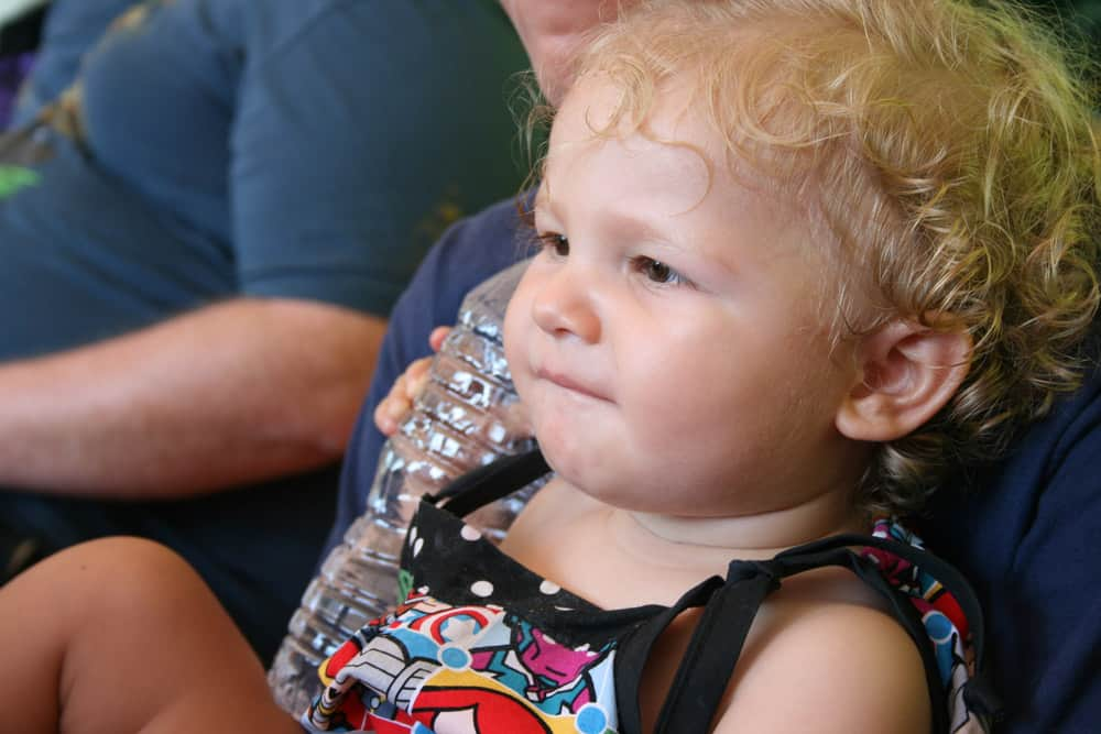 Baby at Disneyland with bottled water