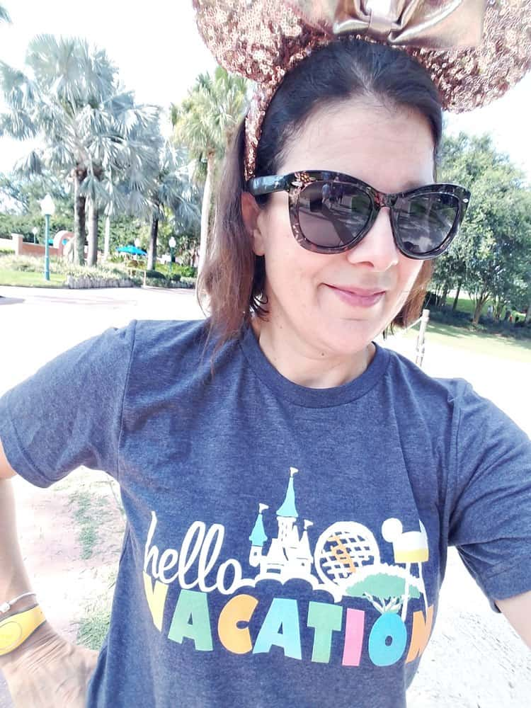 Woman at Disney World wearing Hello Vacation! T-shirt by Polka Dot Pixie Shop
