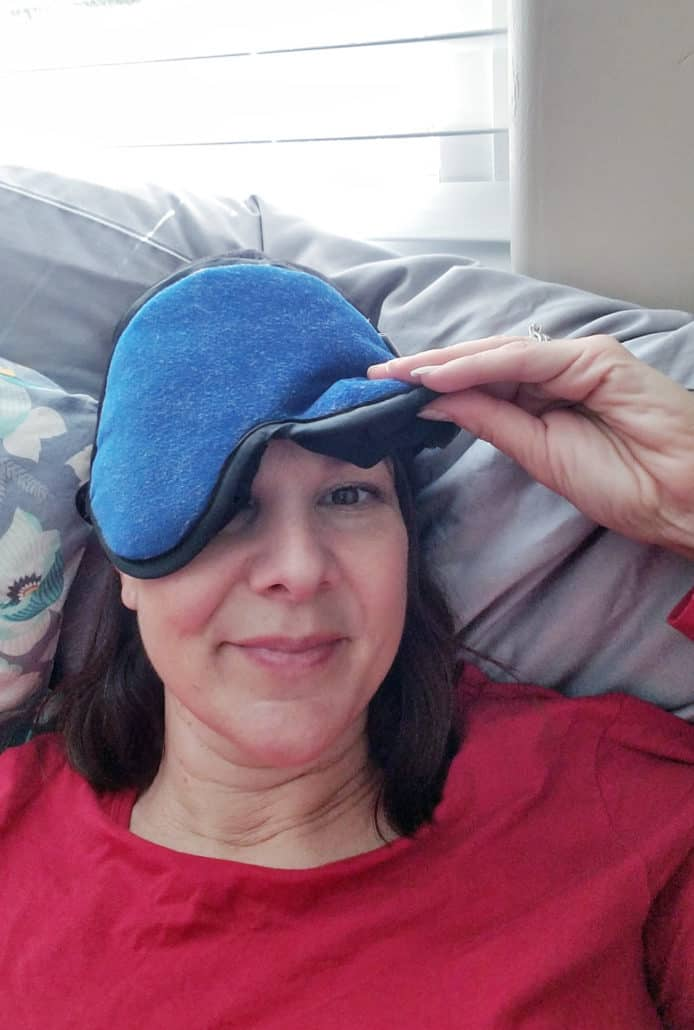 Woman in bed with eye mask