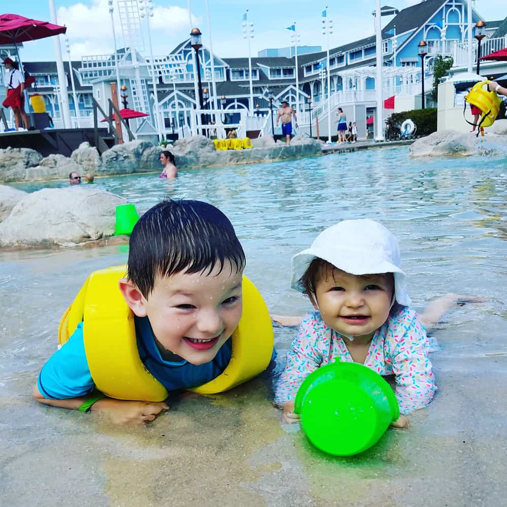Two kids on the beach pool at Beach Club Walt Disney World resort hotel