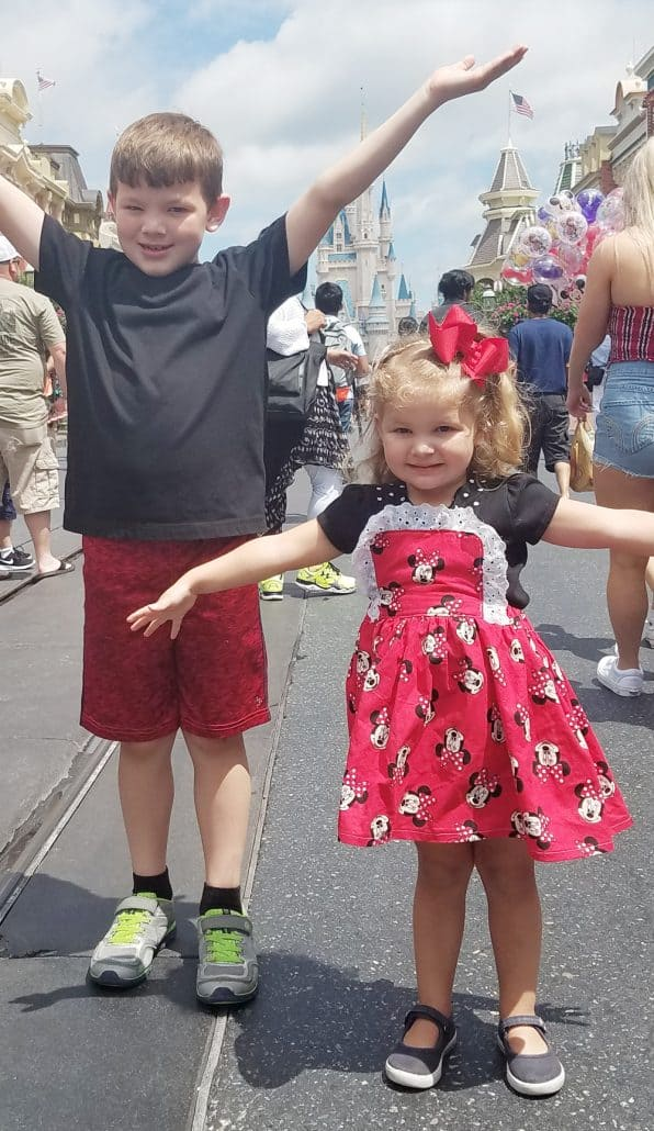 Kids standing on Main Street in Magic Kingdom Disney World