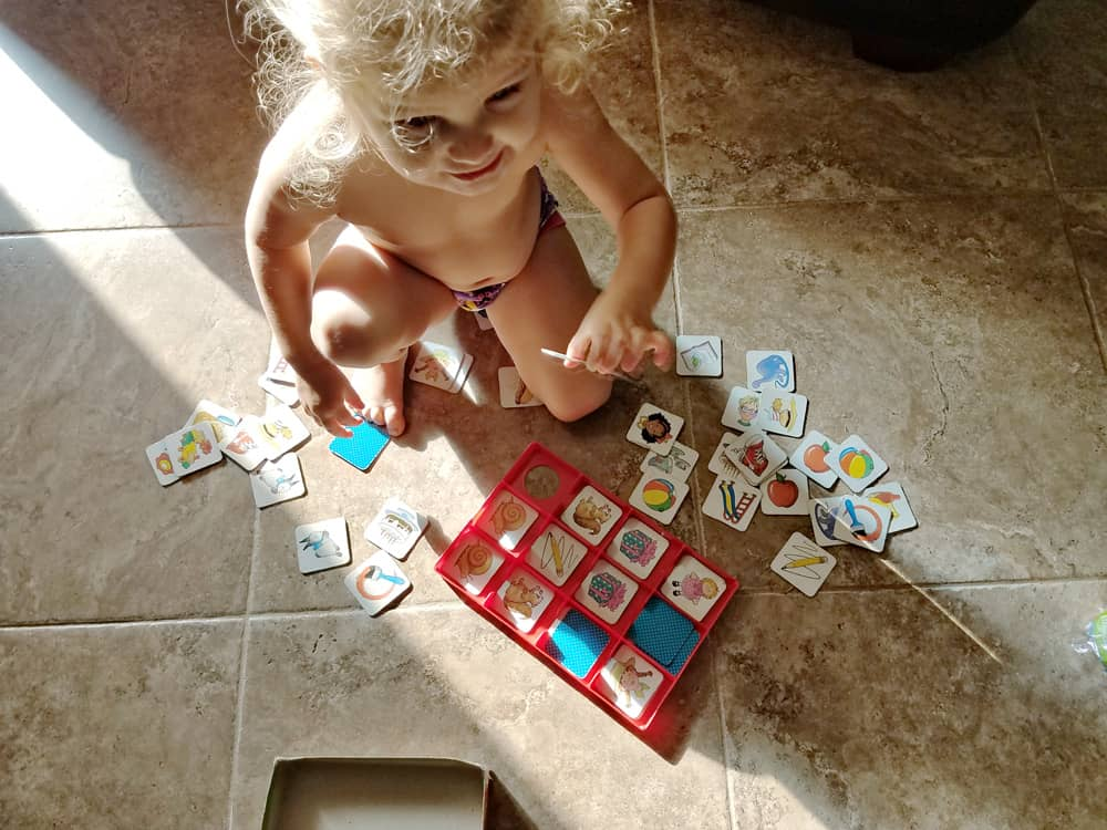 Toddler playing memory match game