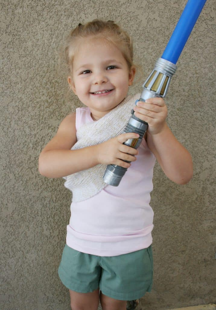 Preschooler holding blue Star Wars light saber