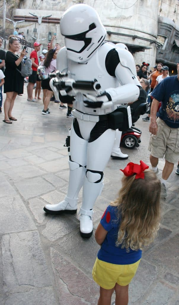 Little girl with Stormtrooper at Disneyland Star Wars: Galaxy's Edge