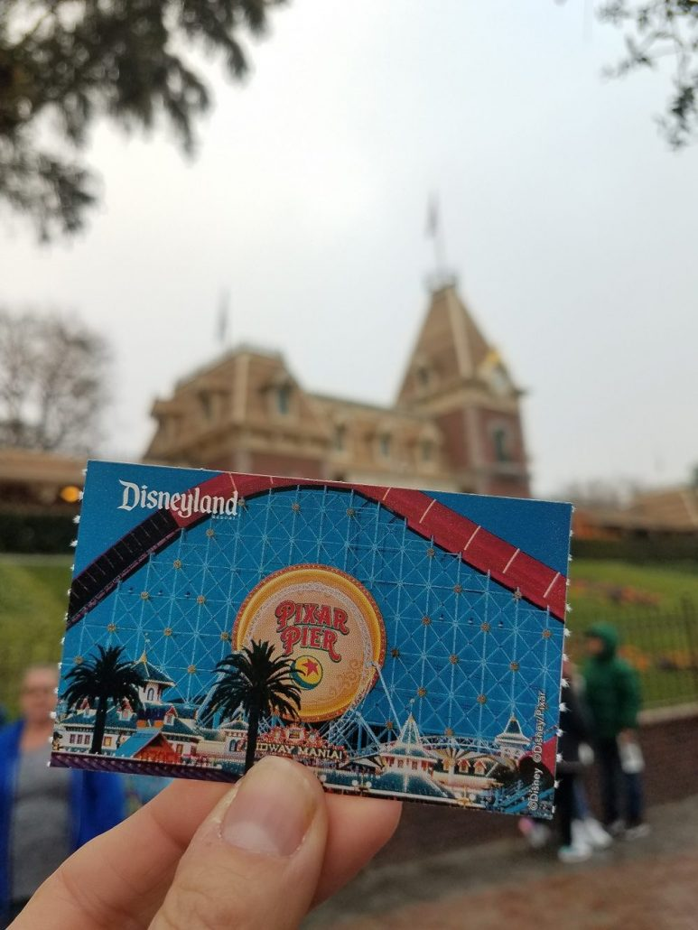 Disneyland ticket held up inside the park