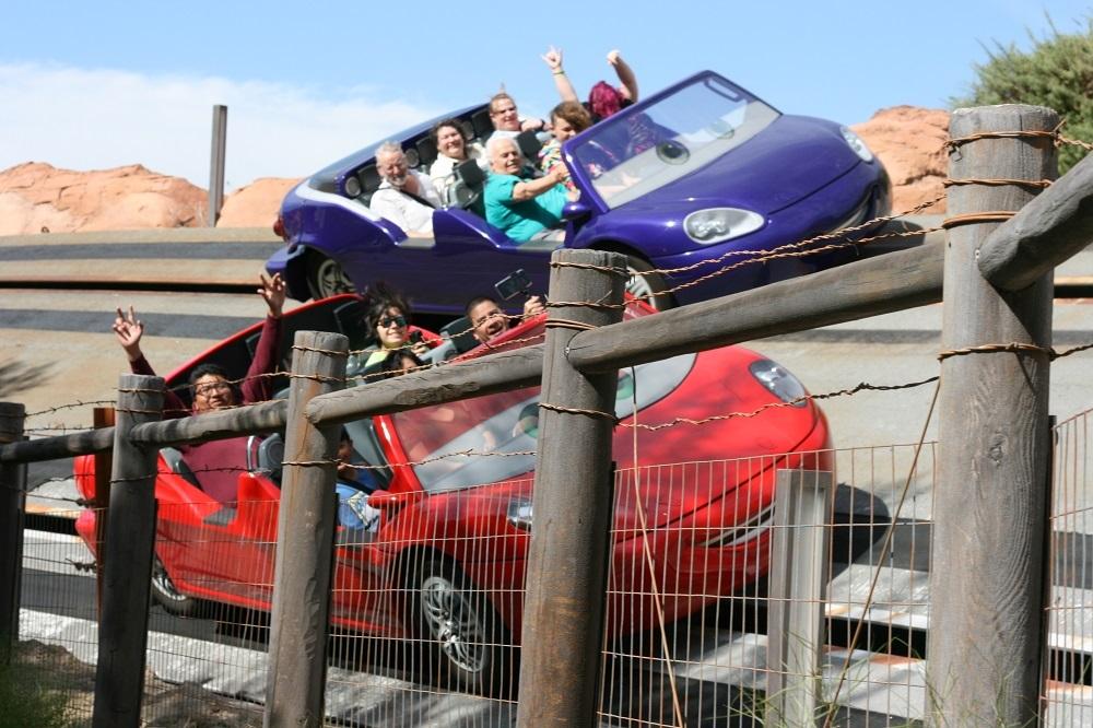 Guests riding Radiator Springs Racers at Disney California Adventure park