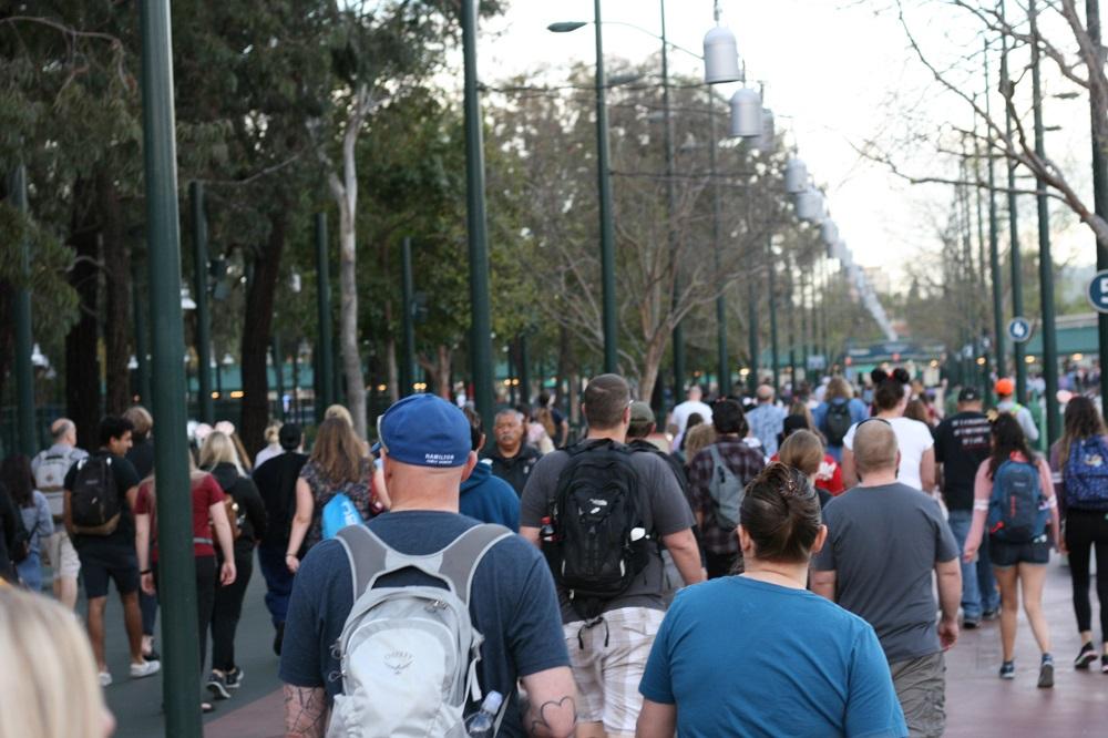 crowds walking towards security at disneyland