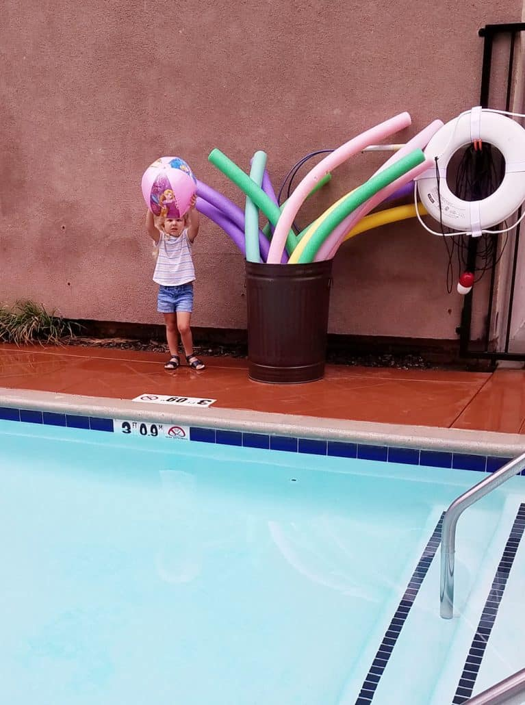 Little girl next to pool at the Hyatt Place Anaheim Resort