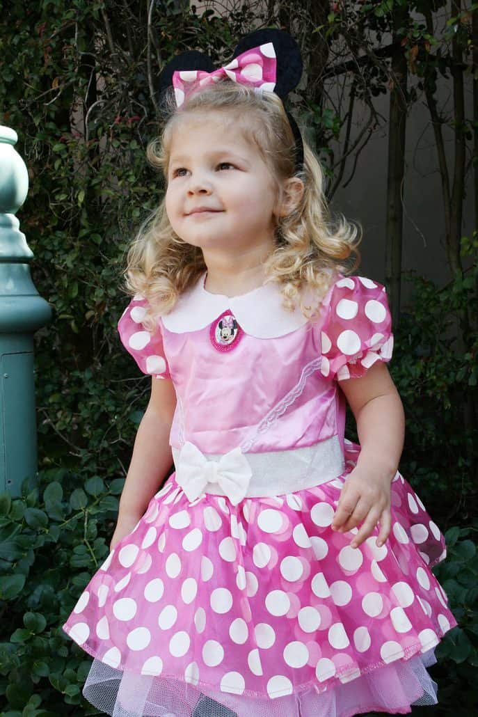 Little girl dressed like Minnie Mouse at Disneyland