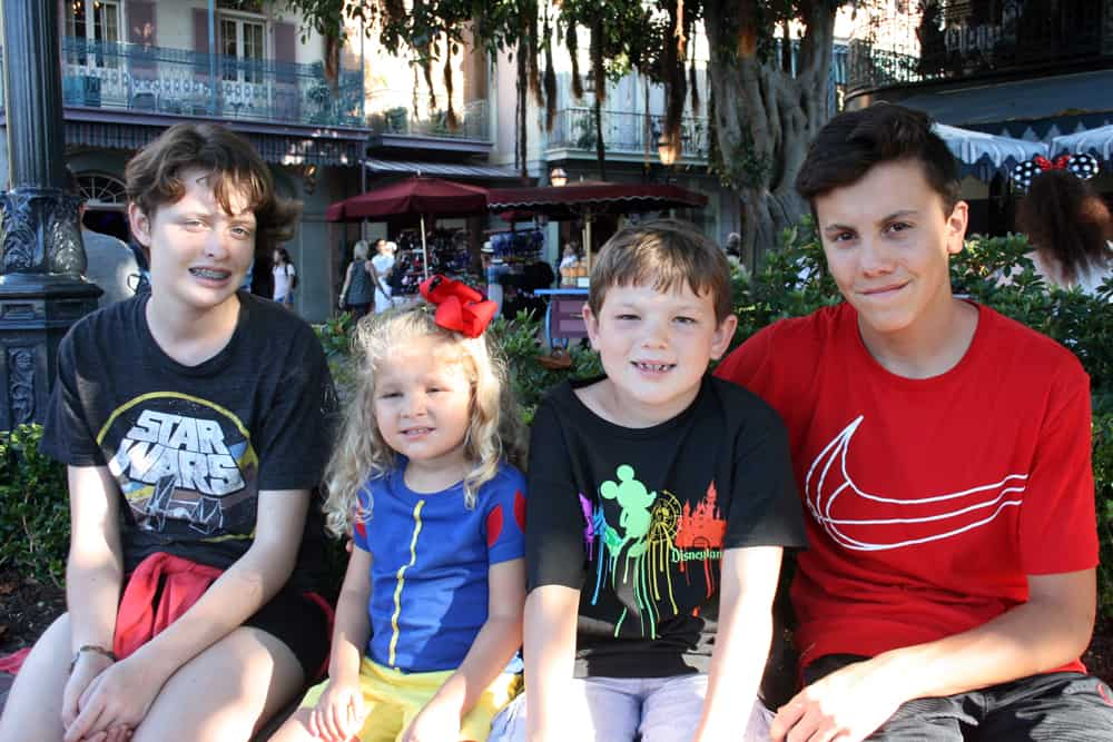 Four kids at Disneyland