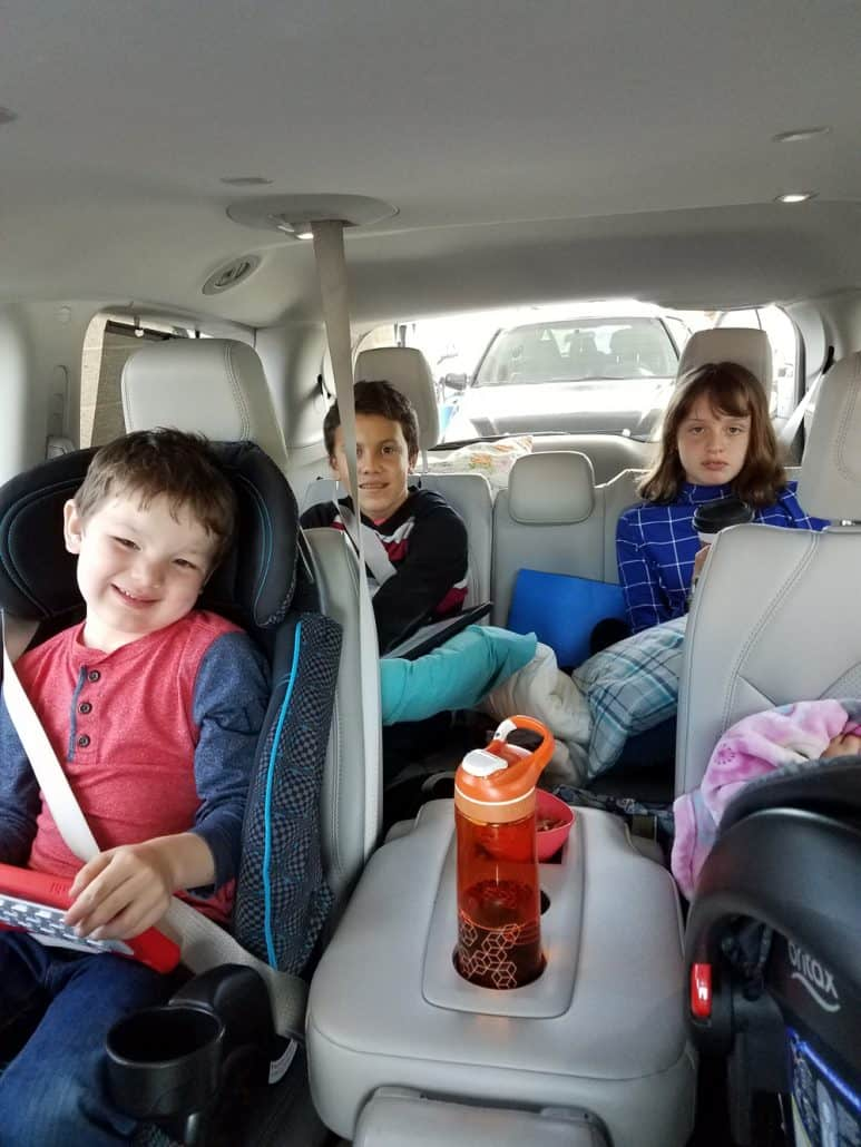 Teens on a road trip inside mini van